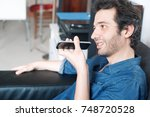 man talking on the phone with... | Shutterstock . vector #748720528