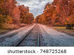 railway track with a curve and... | Shutterstock . vector #748725268