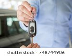 close photo of male car dealer... | Shutterstock . vector #748744906