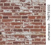 old red brick wall with peeling ...   Shutterstock .eps vector #748751032