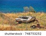 old broken wooden boat on... | Shutterstock . vector #748753252