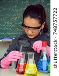 Small photo of Teenager scientist girl, Chemistry class