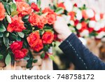 right hand arranging the red...   Shutterstock . vector #748758172