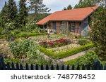 farmhouse with vegetable garden   Shutterstock . vector #748778452