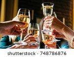 glasses of white wine seen... | Shutterstock . vector #748786876