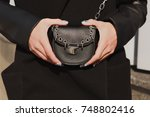 woman's hands holding small... | Shutterstock . vector #748802416