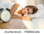 beautiful young woman sleeping... | Shutterstock . vector #748806106