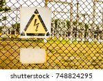 fenced fence and warning sign...   Shutterstock . vector #748824295