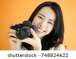 beautiful young woman taking...   Shutterstock . vector #748824622