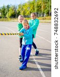 kids on a stadium | Shutterstock . vector #748832692