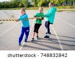 kids on a stadium | Shutterstock . vector #748832842