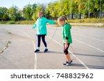 kids on a stadium | Shutterstock . vector #748832962