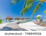 luxury beach resort  bungalow... | Shutterstock . vector #748849036