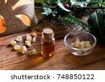 a bottle of frankincense... | Shutterstock . vector #748850122