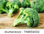 fresh organic broccoli on a... | Shutterstock . vector #748856032