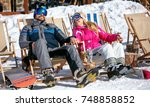 happy couple at mountains in... | Shutterstock . vector #748858852