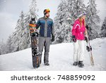 young skiers couple on snowy... | Shutterstock . vector #748859092