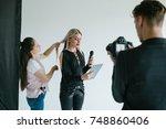 backstage teamwork filming tv... | Shutterstock . vector #748860406