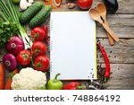 blank recipe book with... | Shutterstock . vector #748864192