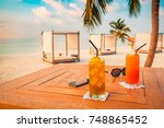 two cocktails and sunglasses on ... | Shutterstock . vector #748865452