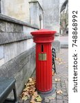 Small photo of Old style Royal Mail red pillar box, letter box, post box outside Town Council Building in Banbury, Oxfordshire, UK