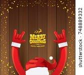vector cartoon santa claus rock ...   Shutterstock .eps vector #748889332