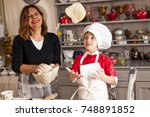 mom and son cooking sweet... | Shutterstock . vector #748891852