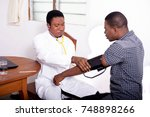 the doctor is controlling the... | Shutterstock . vector #748898266