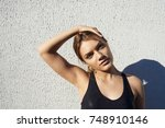 pretty girl with muscular arms... | Shutterstock . vector #748910146