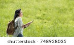 asian traveler with backpack... | Shutterstock . vector #748928035