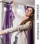 woman falling down ladder...   Shutterstock . vector #748932325