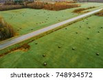 aerial view on green field with ... | Shutterstock . vector #748934572