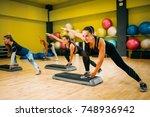 women group on step aerobic... | Shutterstock . vector #748936942
