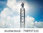 businessman climbing the career ... | Shutterstock . vector #748937122