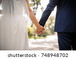 back view of bride in white... | Shutterstock . vector #748948702