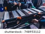 charging the batteries of the... | Shutterstock . vector #748953112