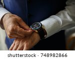 wrist watch on hand of man  men'...   Shutterstock . vector #748982866