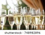 champagne glasses | Shutterstock . vector #748982896