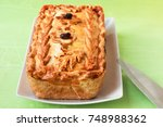 baked meat with pistachios in... | Shutterstock . vector #748988362