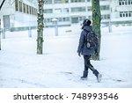 girl schoolgirl with a school... | Shutterstock . vector #748993546