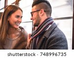 happy couple laughing while... | Shutterstock . vector #748996735
