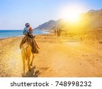 tourists and undefined woman on ... | Shutterstock . vector #748998232