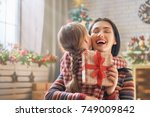 merry christmas and happy... | Shutterstock . vector #749009842