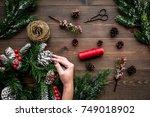 make christmas wreath. hand... | Shutterstock . vector #749018902