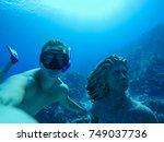 underwater wide angle selfie of ... | Shutterstock . vector #749037736