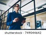 confident male entrepreneur... | Shutterstock . vector #749044642