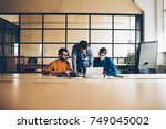 skilled crew of male coworkers... | Shutterstock . vector #749045002