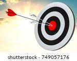 target hit in center by arrows. ... | Shutterstock . vector #749057176