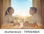 romantic couple having dinner... | Shutterstock . vector #749064865