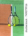 two tennis racket and balls.... | Shutterstock . vector #749079916